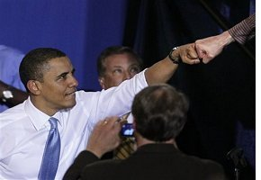 President Barack Obama gives a fist-bump to a supporter after speaking on health insurance reform Thursday, April 1, 2010, at the Portland Expo in Portland, Maine.